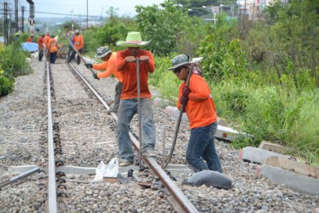Workers install new concrete railroad ties near the Pattaya train station.