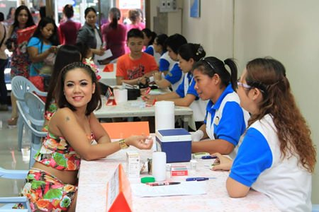 "A Soi 6 employee receives a free blood and health check during this year's ""voluntary counseling and testing day""."