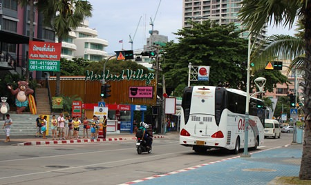 An OA Transport bus races down Beach Road.
