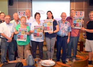 Several PCEC members hold up the current issue of Pattaya Mail as they congratulate Peter Malhotra and the Pattaya Mail staff on their upcoming 21st anniversary.