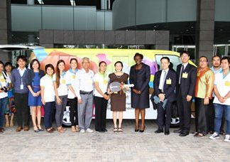 """Officials from Pattaya's Child Protection and Development Center take possession of a """"mobile training unit"""" donated by the United Nations Office on Drugs and Crime and the Japanese Embassy."""