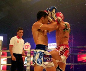 Fighters are shown in action at the Muay Thai Vigo Championship held in Chonburi city, Friday, July 25.
