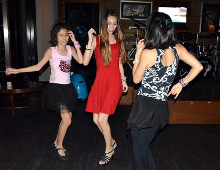 Young, local hipsters get into the Salsa mood at Havana Bar.