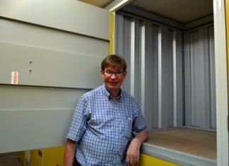 Jan Olav Aamlid, the Managing Director of Pattaya Self Storage demonstrates one of the medium sized lockers.