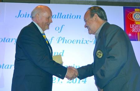 Premprecha Dibbayawan congratulates VP Juergen Schlag (left) who represented President Ingo Raeuber.