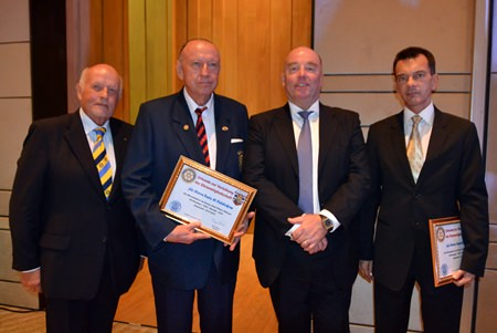 VP Juergen Schlag (left) joins in the lineup as H.E. Rolf Schulze (2nd right) inducts Trutz Fiddikow (2nd left) and Austrian Consul General Rudolf Hofer (right) as honorary members of the Rotary Club Phoenix Pattaya.