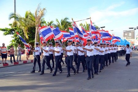 Students from the Asian Maritime Technological College lead the parade down Beach Road.