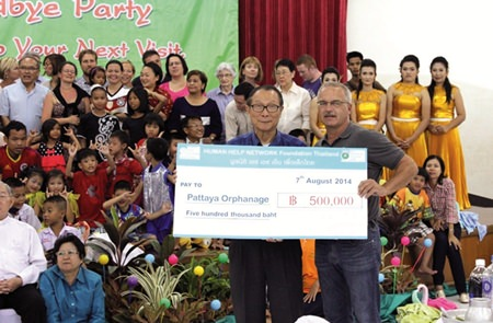 Ewald Dietrich (right) presents Fr. Michael Weera Phangrak a check for 500,000 baht.