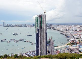 Pattaya officials have halted construction of a 53-story condominium and hotel project at Bali Hai Pier that sparked an Internet firestorm after photos showing the tower obstructing a classic Pattaya viewpoint went viral online. Mayor Itthiphol Kunplome stated that the project - first launched in 2004 - has continually followed correct and fully transparent legal processes and he urged anyone alleging that shortcuts were taken to investigate the various hearings and reports themselves.