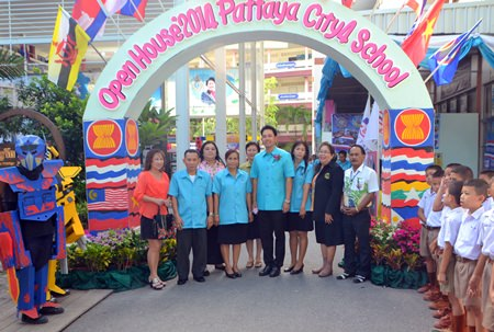"""Mayor Itthiphol Kunplome and school officials open the """"36 Years of Progressive Education & Advanced Technology, Ready for AEC"""" event at Pattaya School No. 4."""