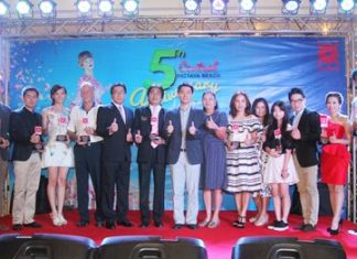 Award winners and presenters pose for a commemorative group photo during the award presentation ceremony.
