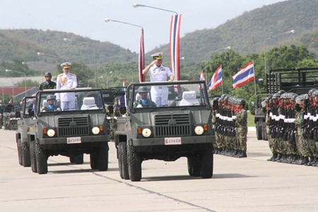 Commanders of the Royal Thai Navy's Air and Coastal Defense Command inspect the troops to marked their 24th anniversary.