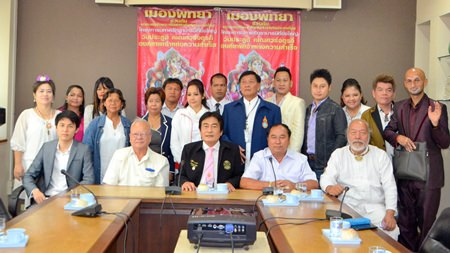 Deputy Mayor Ronakit Ekasingh and Chaiwat Detchonthee, president of Lord Ganesh Worshippers Club, and members announce the festival starting today, Aug. 15 on Soi Buakaow.