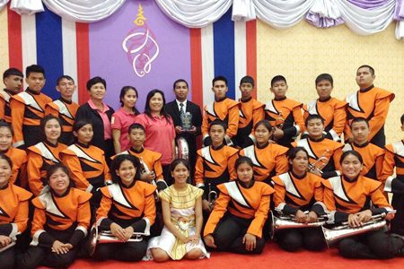 Music teacher Saroj Bunmuang (back row, center) is most proud of the Phothisamphan Phitthayakhan School band winning the HRH Princess Soamsawalee trophy at the 6th Melodeon Music Fair to honor HM the King.