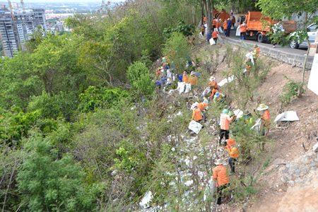 Pattaya municipal officers and over 50 private sector officers help collect trash and waste around the Navy radio station foothills, as it is a popular tourism site and considered a window of Pattaya to the world.