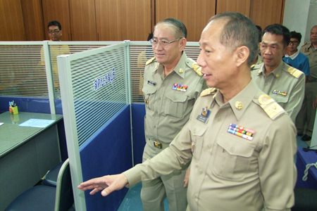 Interior Ministry Permanent Secretary Wiboon Sanguanphong (left) and Chonburi Gov. Khomsan Ekachai (right) tour the Chonburi Operations Center in its temporary office at Chonburi City Hall.