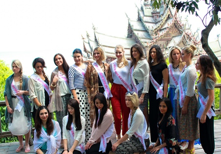 Sixteen of the 25 Miss New Zealand contestants touring Pattaya pose for a photo in front of the Sanctuary of Truth.