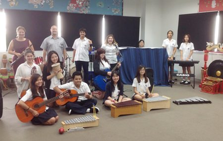 St. Andrew students and teachers work collaboratively on their music compositions.