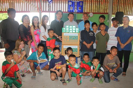 Public officials and business leaders donate medicine and cash to the Anti-Human Trafficking and Child Abuse Center and Baan Jing Jai Orphanage.