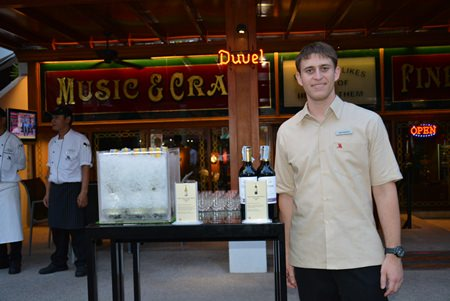 Santiago Bonet, Assistant F&B Manager of Pattaya Marriot Resort & Spa shows off a set of wine bottles.