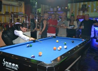 Jimmy White plays for the side pocket in one of his many charity games played last week to raise money for the Father Ray Foundation.