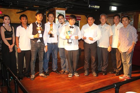 Organizers and winners gather for a group photo after the event. Champion Kitja Khaeikeaw holds the first trophy from the right.