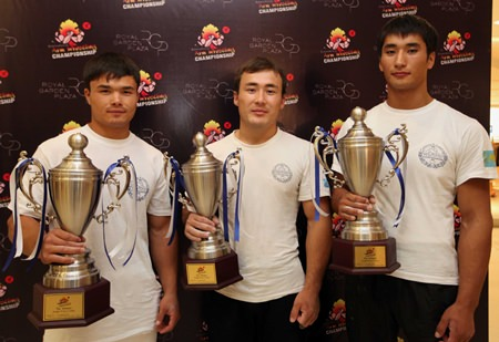 (L to R) Magzhan Shamyiev, winner of the under 75 kg. division; Raikhanov Shynbolat, winner of the under 85 kg. division; and Ongarbayev Kypyrgali, winner of the over 85 kg. division.