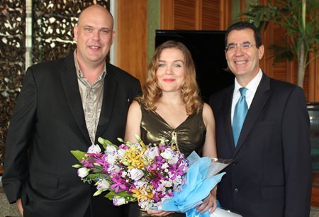 Antonello Passa (right) GM of the Royal Cliff Hotels Group presents a bouquet to Larisa and Marcus.