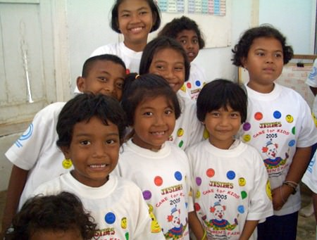 Students from Sang Ga U School on Koh Lanta wearing Jesters T-shirts. Jesters sponsored their lunches through WWM after the tsunami.