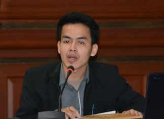 Suratatyotin Burananon, vice chairman of the Youth Council Region 3, presides over the meeting