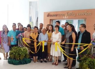 Sopin Thappajug (center), executive director of the Diana Group, along with members of area Lions clubs, cuts the ribbon to officially open the new medical center at Pattaya School #7.