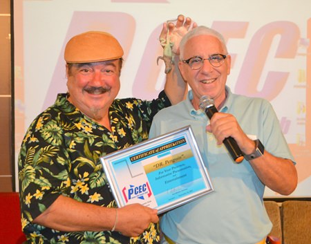 What is that creature Dr. Penguin pulled out of MC Richard Silverberg's ear as Richard was presenting him with the PCEC's Certificate of Appreciation for his entertaining presentation to the Club?