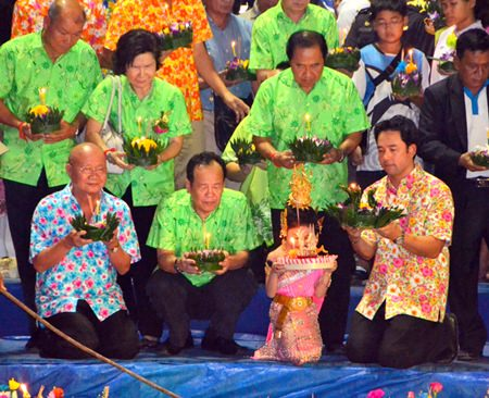 Mayor Itthiphol Kunplome and members of the Pattaya City Council join people in floating their krathongs at Lan Pho Public Park.