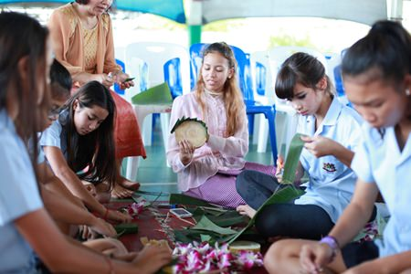 Secondary students from GIS have fun making their krathong.