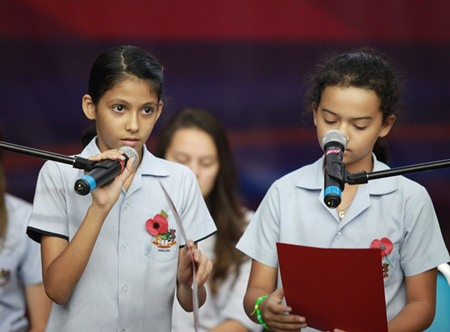 GIS students read out anti-war poetry at a whole school assembly.