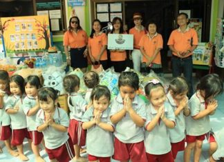 Children at the Father Ray Day Care Center say thank you to members of the Lions Club of Pratamnak for donating rice, food and supplies.