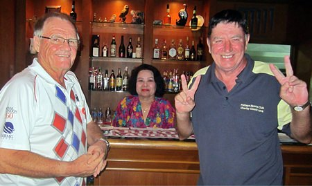 Winners Derek Brook (left) and John Hackett (right) celebrate with Lek at BJ's Holiday Lodge.
