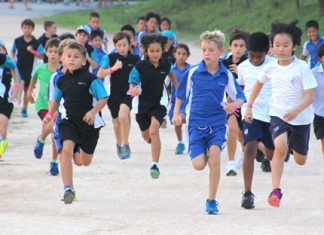 St Andrews student Ben Harcourt-Harrison (centre-right) leads the pack from start to finish in the boys under 11 race.