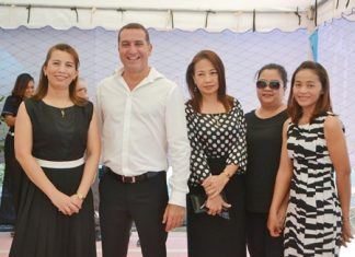 Matrix Managing Director Miki Haim (2nd left) poses with staff members and friends at the opening party for the City Center Residence showrooms on Dec. 11.