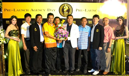 Bandit Siritanyok, CEO of 888 Villas (white jacket) is congratulated by members of Pattaya City council during the pre-launch agency day.