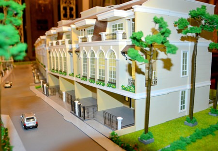 A scale model shows a typical design of the project's town homes.