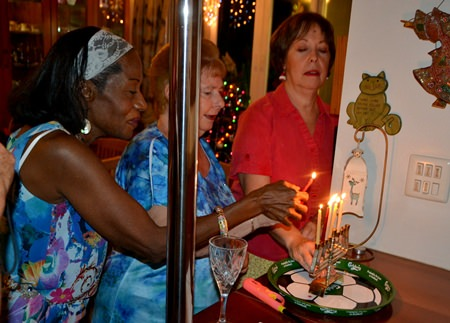 Guests bond together to light one of the menorah candles