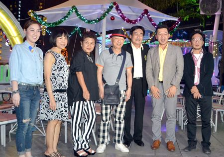 Ronakit Ekasingh (3rd right), the deputy mayor of Pattaya, joins Alcazar board member Suthat Phetctrakul and honoured guests during the grand opening of the Triangle Bar and Karaoke venue on Dec. 23.