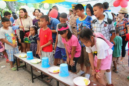 Children line up to play games and win prizes at the Sea Turtle Conservation Center in Sattahip.