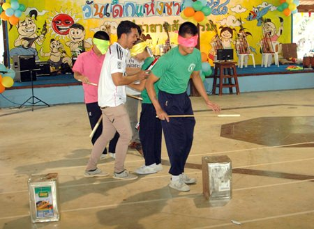 """Children with limited or no vision participate in the """"hit the bucket while blindfolded"""" game held at the Sanctuary of Truth."""