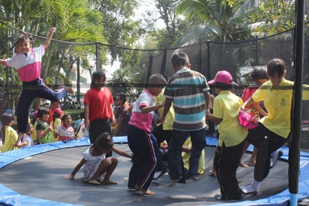 Children enjoy themselves at the trampoline cage in Nongprue.