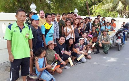 Happy volunteer wall painters gather for a group photo.