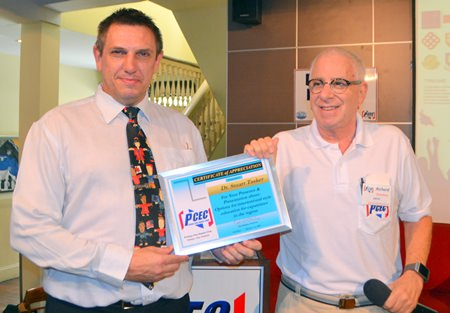 MC Richard Silverberg presents the PCEC's Certificate of Appreciation to Dr. Stuart Tasker for his interesting and informative talk about the educational benefit of attending international schools in Thailand.