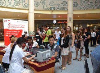 Residents and staff of Big C North Pattaya wait in line to take a blood test before donating to help people in need.