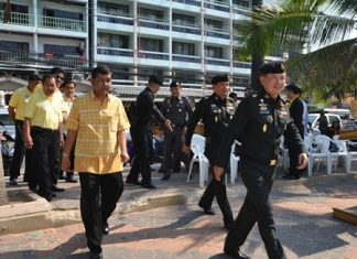 Maj. Gen. Nirandorn Samutsakorn, commander of 14th Military Circle in Chonburi, arrives to spearhead the beach cleanup.